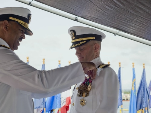 Navy Capt. Charles A. Johnson, right, received a letter of censure this month from Navy Secretary Richard Spencer for transgressions related to the