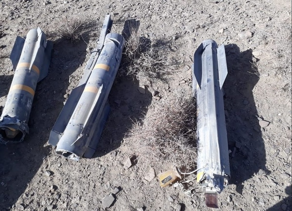 AGM-114 Hellfire missiles from the MQ-9 Reaper's wreckage are laid out for photos. (Screenshot)