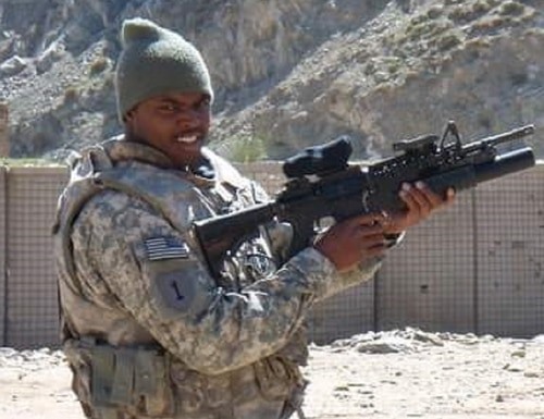 Master-at-Arms 1st Class Patrick Gilyard, shown here during a deployment to Afghanistan, has died in Florida following a medical emergency while on deployment to El Salvador. (PJ Gilyard via Facebook)
