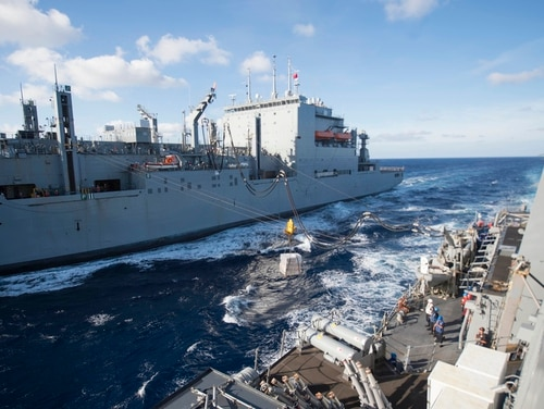 A civilian mariner died late last month after a 25-foot fall on the dry cargo ship William McLean, shown here resupplying the guided-missile destroyer Carney in 2016. (Navy)