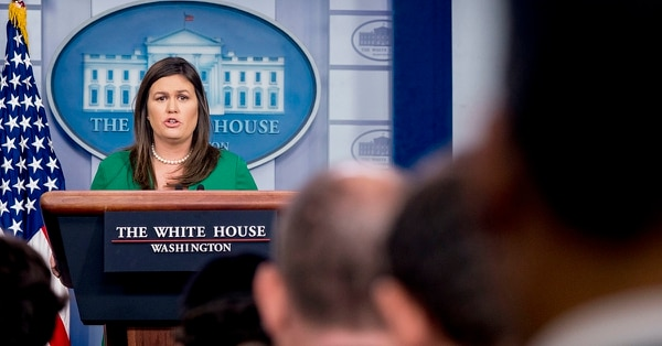 White House press secretary Sarah Huckabee Sanders reads a statement from President Donald Trump announcing that he will remove the security clearance from former CIA Director John Brennan during the daily press briefing at the White House, Wednesday, Aug. 15, 2018, in Washington. Sanders said the president will be reviewing the security clearances for a number of other former officials. (Andrew Harnik/A{)