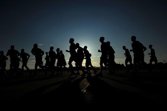 Airmen participate in a Warrior Run. (Staff Sgt. Rasheen A. Douglas/Air Force)