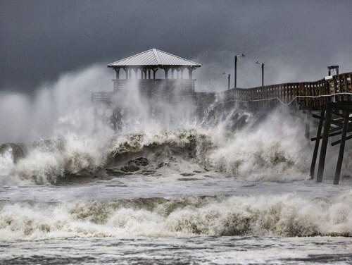 Waves slam the Oceana Pier & Pier House Restaurant in Atlantic Beach, N.C., Sept. 13, 2018, as Hurricane Florence approaches the area. (Travis Long /The News & Observer via AP)