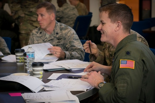 Lt. Col. Nicholas Rowe, 423rd Mobility Squadron commander, participates in an exercise scoring records of enlisted Airmen at Joint Base San Antonio-Randolph, Texas, March 19, 2019. The Air Force began holding squadron commander courses virtually in May due to the coronavirus. (Staff Sgt. Sahara Fales/Air Force)