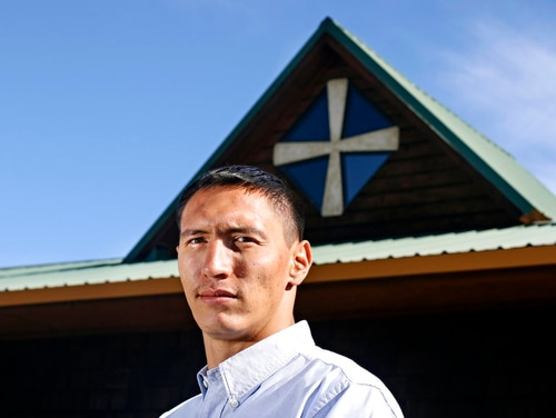 In this Oct. 5, 2017 photo, Jesse DesRosier, a Marine veterans and Blackfoot language instructor at Cuts Wood School poses in Browning, Mont. DesRosier's 28-year journey is a dizzying endeavor, even if he's right back where he started - living on the Blackfeet Indian Reservation. (Greg Lindstrom /Flathead Beacon via AP)