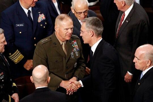 Then-Marine Corps Commandant Gen. Robert Neller, left, speaks with NATO Secretary-General Jens Stoltenberg after Stoltenberg addressed a joint meeting of Congress on Capitol Hill in Washington, April 3, 2019. (Patrick Semansky/AP)