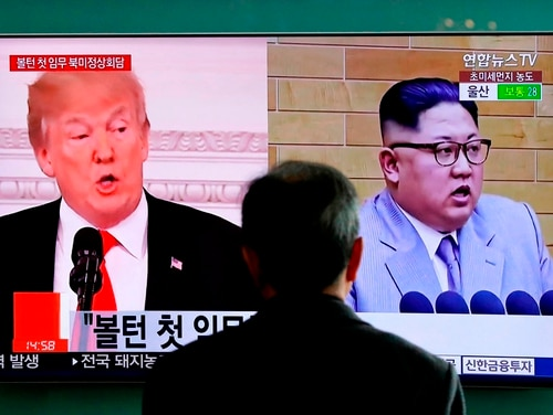 In this March 27, 2018, file photo, a man watches a TV screen showing file footage of U.S. President Donald Trump, left, and North Korean leader Kim Jong Un during a news program at the Seoul Railway Station in Seoul, South Korea. (Lee Jin-man/AP)