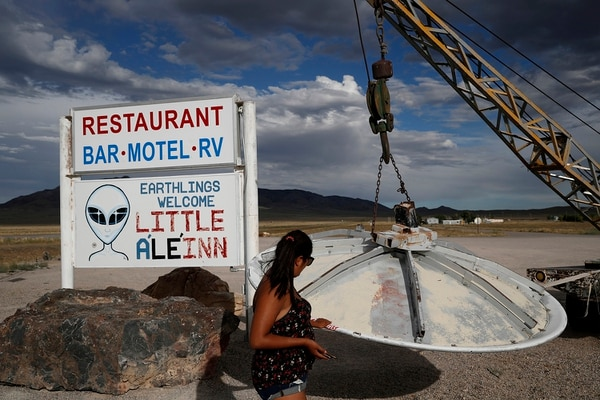 Grace Capati looks at a UFO display July 22 outside of the Little A'Le'Inn, in Rachel, Nev., the closest town to Area 51. (John Locher/AP)