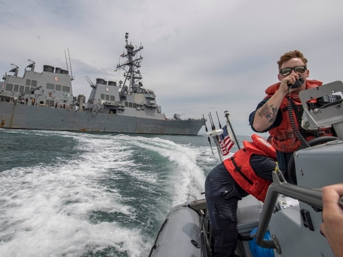Boatswain's Mate 3rd Class Timothy Mallon radios the bridge on board the guided-missile destroyer Carney during a July 9 visit, board, search and seizure drill in the Black Sea. (Mass Communication Specialist 1st Class Fred Gray IV/Navy)