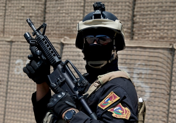A member of the Iraqi Counter Terrorism Service forces participate in a training exercise as U.S. Defense Secretary Ash Carter observes at the Iraqi Counter Terrorism Service Academy on the Baghdad Airport Complex in Baghdad, Iraq, Thursday, July 23, 2015. Carter is on a weeklong tour of the Middle East focused on reassuring allies about Iran and assessing progress in the coalition campaign against the Islamic State in Syria and Iraq. (AP Photo/Carolyn Kaster, Pool)