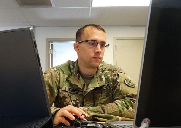 Staff Sgt. Brian Jones, an intelligence analyst with the 102nd Information Operations Battalion, monitors his workstation to counter the Red Team's efforts to hack into his system. (Maj. Ray McCulloch/Army)