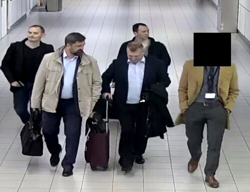 Four Russian officers with the GRU military spy agency are escorted to their flight after being expelled from the Netherlands on April 13, 2018, for allegedly trying to hack into the U.N. chemical watchdog OPCW's network. The Dutch defense minister on Thursday, Oct. 4, 2018, accused Russia's military intelligence unit of attempted cybercrimes targeting the U.N. chemical weapons watchdog and the investigation into the 2014 Malaysian Airlines crash over Ukraine. (Dutch Defense Ministry via AP)
