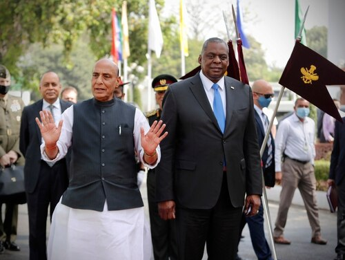Indian Defense Minister Rajnath Singh walks with U.S. Defense Secretary Lloyd Austin as the latter arrives for a Guard of Honor ceremony in New Delhi, India, March 20, 2021. (Manish Swarup/AP)