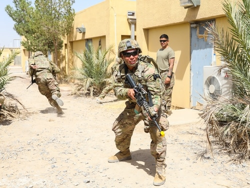 Soldiers from the unit that provided security during the insider attack are pictured here training months earlier on Kandahar Airfield, Afghanistan. (Staff Sgt. Neysa Canfield/Army)