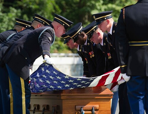 The 3rd Infantry Regiment, also known as the Old Guard, casket teams stretch the American flag over the casket containing the remains of one of two unknown Civil War Union soldiers to their grave at Arlington National Cemetery in Arlington, Va., Thursday, Sept. 6, 2018. The soldiers were discovered at Manassas National Battlefield and will be buried in Section 81. Arlington National Cemetery opened the new section of gravesites with the burial. (Cliff Owen/AP)