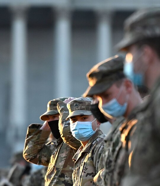 Members of the National Guard stand at attention after arriving on Capitol Hill on Jan. 12, 2021, in Washington. (Andrew Caballero-Reynolds/AFP via Getty Images)