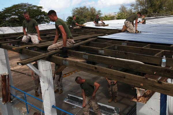 130418-M-LN208-027 AGAT, Guam – Marines repair a stage at Marcial A. Sublan Elementary School April 18 during Exercise Guahan Shield. Guahan Shield facilitated multiservice engagements, set conditions for bilateral and multilateral training opportunities, and supported rapid response to potential theater crises and contingency operations in the Asia-Pacific region. The Marines are part of Combat Logistics Detachment 39, 9th Engineer Support Battalion, 3rd Marine Logistics Group, III Marine Expeditionary Force. (U.S. Marine Corps photo by Lance Cpl. Pete Sanders/released)