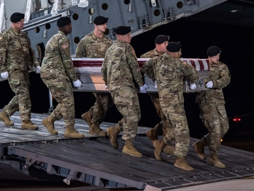 Soldiers conduct a dignified transfer of Staff Sgt. Dustin M. Wright's remains at Dover Air Force Base, Delaware, on Oct. 5, 2017.