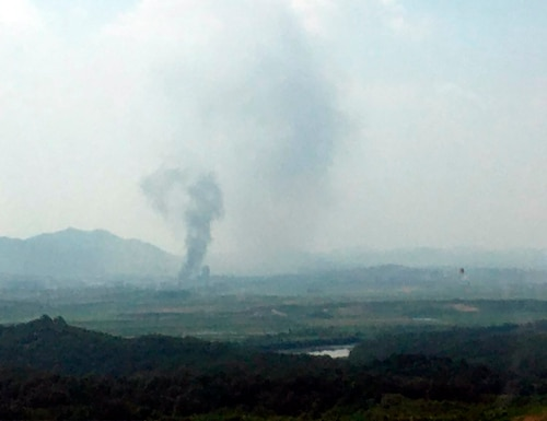 Smoke rises in the North Korean border town of Kaesong, seen from Paju, South Korea, Tuesday, June 16, 2020. South Korea says that North Korea has exploded an inter-Korean liaison office building just north of the tense Korean border. (Yonhap via AP)