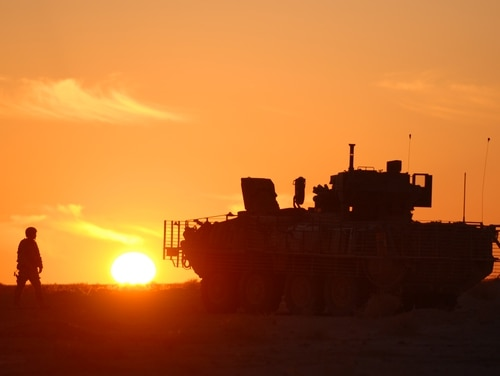 A soldier makes his way back to his Stryker armored vehicle as B Co. 4th Battalion 9th Infantry Regiment makes its way to an objective in the desert west of Baji, Iraq, Monday, 2/6/2008.