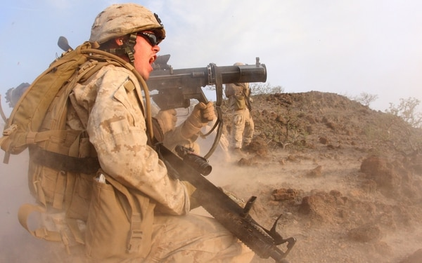 Assaultmen from Weapons platoon, Alpha Company, Battalion Landing Team 1st Battalion, 9th Marine Regiment, 24th Marine Expeditionary Unit, launch a high explosive rocket from an MK153 Shoulder-fired, Multi-purpose, Assault Weapon (SMAW) in the mountains of Djibouti, Africa, during a live fire range in 2010. (Gunnery Sgt. Chad R. Kiehl/Marine Corps)