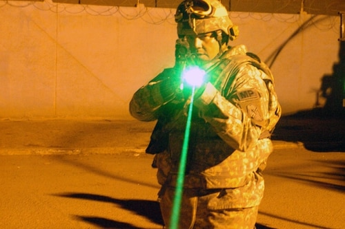 Troops have seen nonlethal weapons alternatives grow from flashlights to a host of visual, audio and physical tools to stop individuals short of lethal force. (Spc. Edward Siguenza/Army)