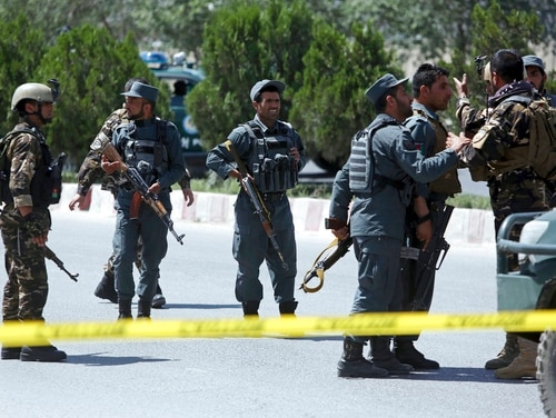 Afghan Security personnel stand guard at the site of a deadly attack on the interior ministry in Kabul, Afghanistan, Wednesday, May 30, 2018. Afghan officials said a suicide bomber struck outside the ministry, allowing gunmen to pass through an outer gate where they traded fire with security forces, who eventually killed the attackers. (Rahmat Gul/AP)