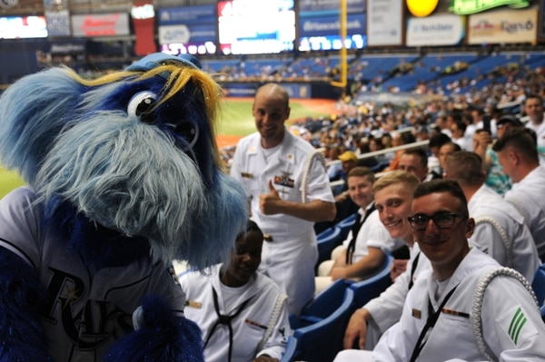 Raymond, the Tampa Bay Rays mascot, mugs with sailors during a Tampa Navy Week event at Tropicana Field in St. Petersburg, Fla. (Navy)