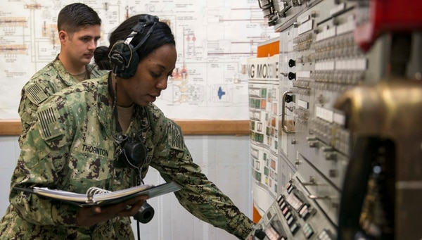 Machinist's Mate (Weapons) 2nd Class Jalissa Thornton, assigned to the guided-missile submarine Michigan, practices loading and firing torpedoes at Trident Training Facility Bangor on June 21. (Mass Communication Specialist 1st Class Amanda R. Gray/Navy)