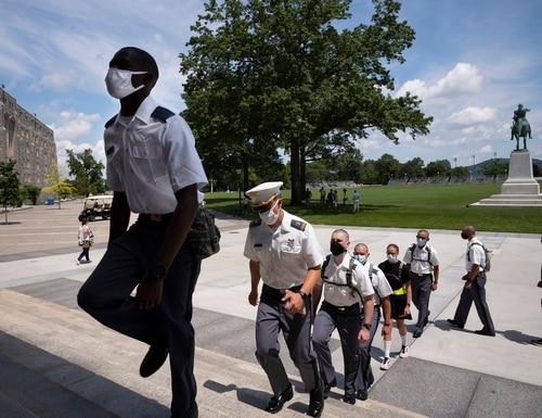 Like these new cadets marching in formation July 13, 2020, at the U.S. Military Academy in West Point, everyone on a military installation is now required to wear a mask, even outside. (Mark Lennihan/AP)