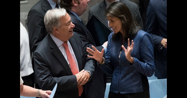United Nations Secretary-General Antonio Guterres, left, talks to American Ambassador to the United Nations Nikki Haley before a Security Council meeting on threats to international peace and security caused by terrorist acts, Thursday, Aug. 23, 2018 at United Nations headquarters. (Mary Altaffer/AP)