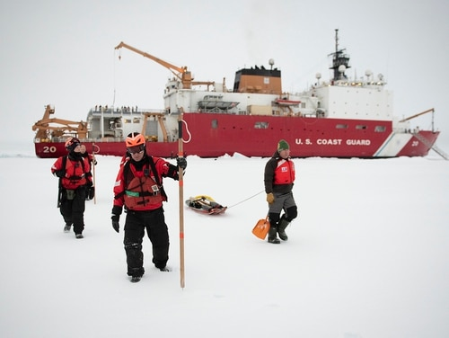 Two Coast Guardsmen and a scientist walk on the frozen Arctic Sea from the Coast Guard Cutter Healy (WAGB-20) to conduct an ice survey Oct. 2, 2018, about 715 miles north of Barrow, Alaska. (NyxoLyno Cangemi/U.S. Coast Guard)