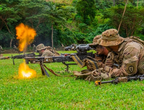 Soldiers train with blank ammunition in a 240B machine gun during a military tactics demonstration at a Fijian cadet graduation in Napuka Village, Fiji, Aug. 7, 2019. (Sgt. 1st Class Whitney Houston/Army)