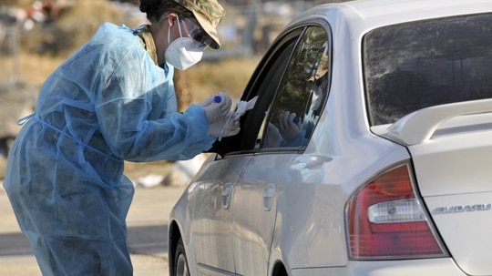 A Nevada Guard troop conducts a carside coronavirus test at the Reno-Sparks Indian Colony in Hungry Valley, Nev., on Nov. 12, 2020. (1st Lt. Emerson Marcus/Air Force)