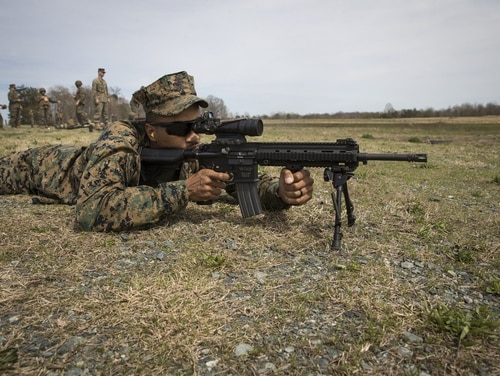 A U.S. Marine with Headquarters and Service Battalion fires the M27 Infantry Automatic Rifle during a live-fire weapons familiarization exercise at Marine Corps Base Quantico, Virginia, April 5. (Lance Cpl. Micha R. Pierce/Marine Corps)
