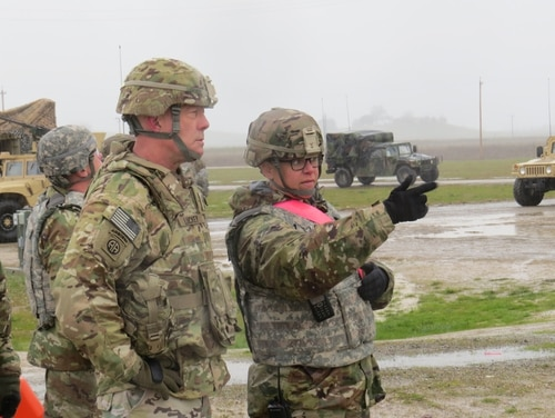Army Reserve commander Lt. Gen. Charles Luckey receives a range orientation brief from Capt. Cindy Stockamp of the 451st Sustainment Command. Luckey recently spoke about the need to make strategic decisions about the Reserve's use in a near-peer fight. (Army)