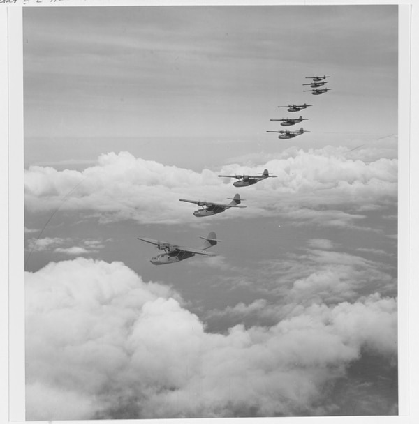 Consolidated PBY-5 patrol bombers fly in formation in the Hawaiian area, circa November 1941. These planes, from Patrol Squadron 14 (VP-14), arrived on Oahu on 23 November 1941. The plane closest to the camera is 14-P-1, which on 7 December 1941 was flown during the attack by the destroyer Ward on a Japanese midget submarine. (National Archives)