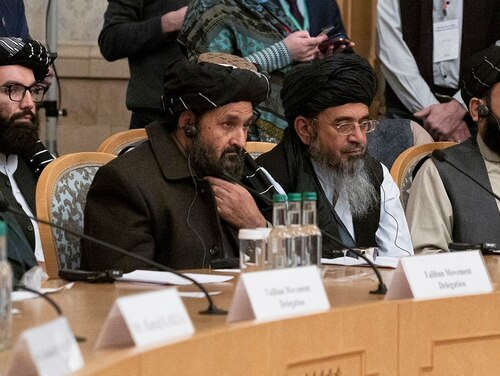 In this March 18, 2021, file photo, Taliban co-founder Mullah Abdul Ghani Baradar, center, with other members of the Taliban delegation attends an international peace conference in Moscow. (Alexander Zemlianichenko/Pool via AP)