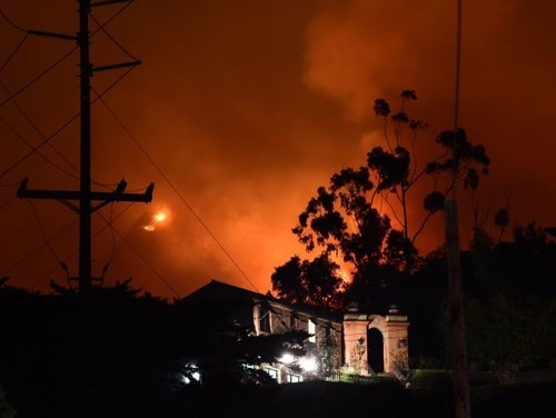 Flames from the Thomas Fire burn in the hills above homes in Montecito, California, east of Santa Barbara, on Dec. 11. (Robyn Beck/AFP/Getty Images)