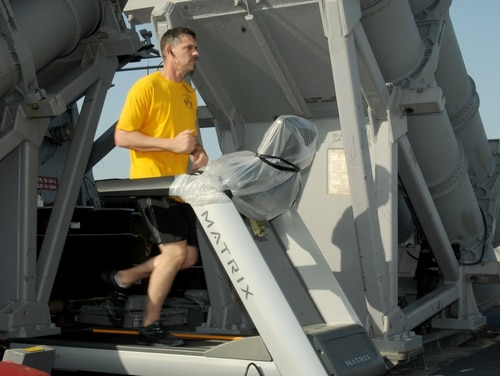 140324-N-CH661-037 MEDITERRANEAN SEA (March 24, 2014) - Command Master Chief Joseph O'Brien, of the guided-missile destroyer USS Ramage (DDG 61), runs on a treadmill on the missile deck in preparation for the physical readiness test. Ramage, homeported in Norfolk, Va., is on a scheduled deployment supporting maritime security operations and theater security cooperation efforts in the U.S. 6th Fleet area of operations. (U.S. Navy photo by Mass Communication Specialist 2nd Class Jared King/Released) Join the conversation on <a href=