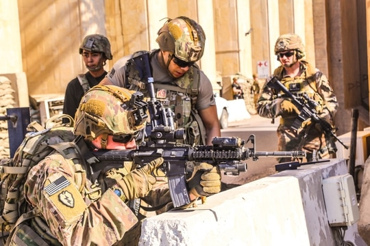 American soldiers taking position around the U.S. Embassy in Baghdad on Dec. 31, 2019, after supporters and members of the Hashed al-Shaabi military network breached the outer wall of the diplomatic mission during a rally to vent anger over weekend airstrikes that killed pro-Iran fighters in western Iraq. (U.S. Embassy in Iraq/AFP via Getty Images)