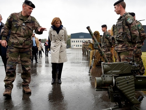 French Armed Forces Minister Florence Parly, center, flanked by Col. Francois Mariotti, left, visits a battalion Oct. 6, 2017, in Bitche, eastern France. (Jean-Christophe Verhaegen/AFP via Getty Images)