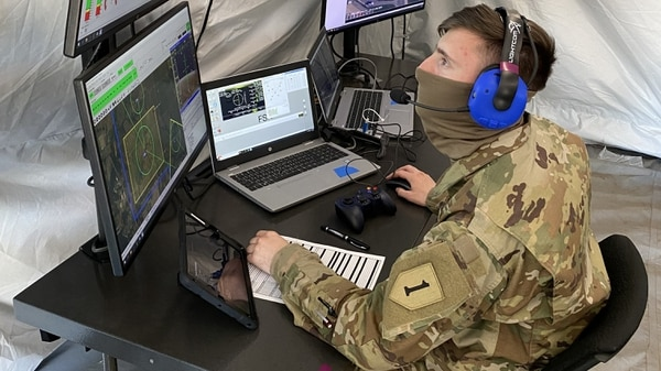 Spc. Nicholas Miller, assigned to 1st Engineer Battalion, 1st Infantry Division, conducts flight operations through a laptop-based ground-control station during the FTUAS capabilities assessment at Fort Riley, Kansas, on April 8, 2020. (Program Executive Office Aviation)