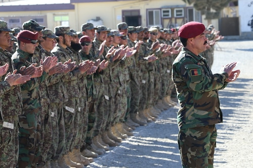 Students from the 24th Commando Qualification Course applaud during their induction ceremony at the Afghan National Army Special Operations School of Excellence, Camp Commando, Kabul, Afghanistan, on Jan. 24, 2018. (Mr. Robert Ditchey/DoD)