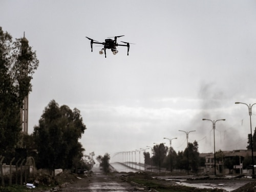 Iraqi forces test fly a drone carrying two grenades in Mosul March 14. They aimed to use the drone against Islamic State fighters. ISIS used small drones to drop explosives on advancing Iraqi forces as they battled to retake the rest of the city in October. Now, Iraqi forces have adopted the tactic, equipping their own remote-controlled devices with 40mm grenades.( Aris Messinis/AFP/Getty Images)