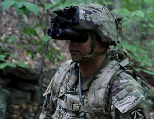 Sgt. 1st Class William Roth gets ready to step off for an overnight hike to the summit of Mount Monadnock, N.H., using the Enhanced Night Vision Google-Binocular during testing of the system in July 2019. (Patrick Ferraris/U.S. Army)