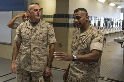 Lt. Col. Joshua Kissoon, at right in 2014, has pleaded guilty Monday to dereliction of duty, making false official statements and conduct unbecoming of an officer. (Cpl. David Bessey/Marine Corps)
