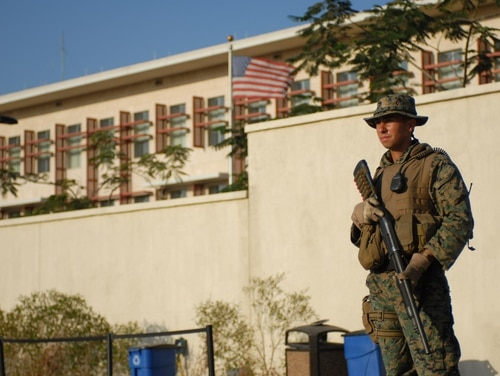 A U.S. Marine from Alert Contingency Platoon 6, 1st Fleet Anti-terrorism, Norfolk, Virginia, stands guard outside the U.S. embassy in support of Operation Unified Response. (Sgt. Richard Andrade/Army)