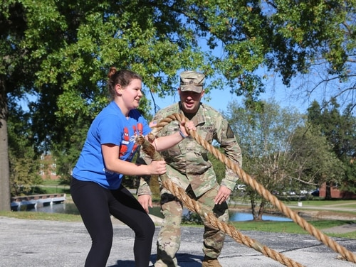 A Missouri Army National Guard recruiter leads a prospective soldier in a fitness routine. Army Recruiting Command is offering thousands in extra pay for recruiters who extend their assignments. (Spc. Garrett A. Bradley/Army)