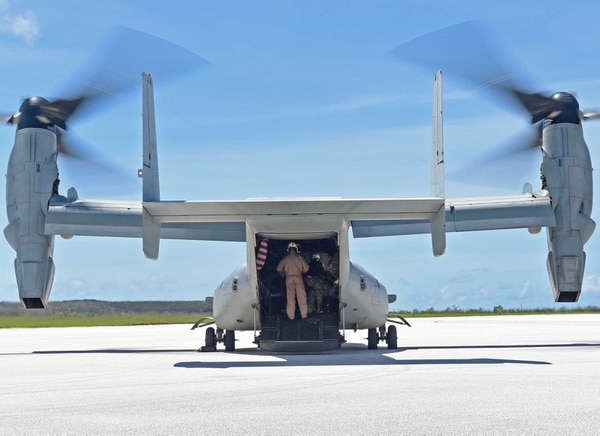 150809-N-KM939-214 SAIPAN INTERNATIONAL AIRPORT, Saipan (Aug. 9, 2015) - An MV-22 Osprey tilt rotor aircraft assigned to Marine Medium Tiltrotor Squadron (VMM) 265 (Reinforced) prepares to take off at Saipan International Airport for a tour of the affected areas with military and civilian officials. VMM 265 is assigned to the Bonhomme Richard Expeditionary Strike Group on patrol in the Navy's 7th Fleet area of operations. (U.S. Navy photo by Mass Communication 3rd Class David A. Cox/Released)